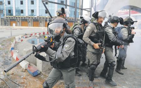 Израильские силовики действуют предельно сдержанно, но решительно. Фото Reuters